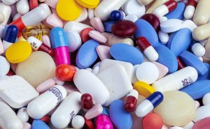 An image of an assortment of pills meant to signify how much we depend and spend on medication