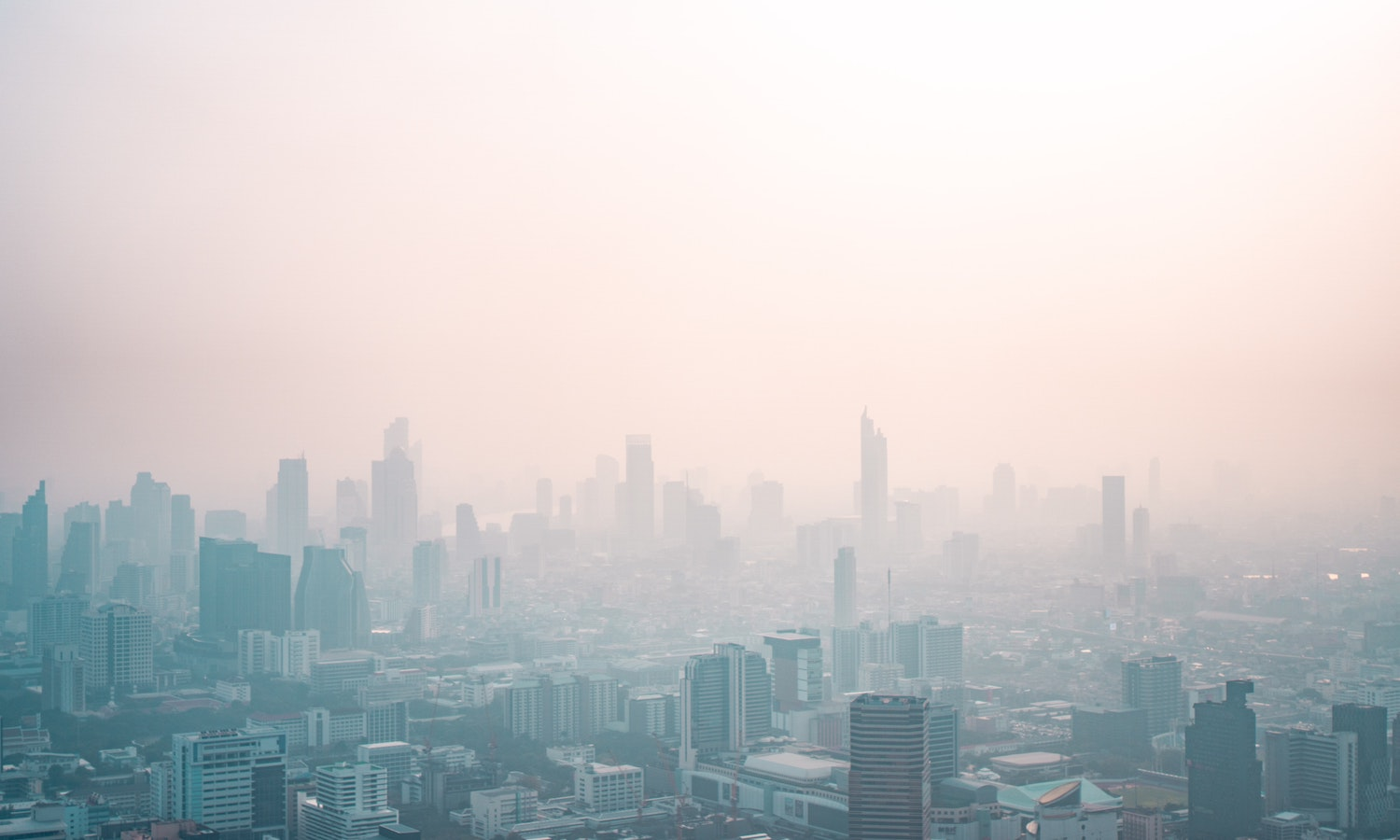 Thick smog over a busy city