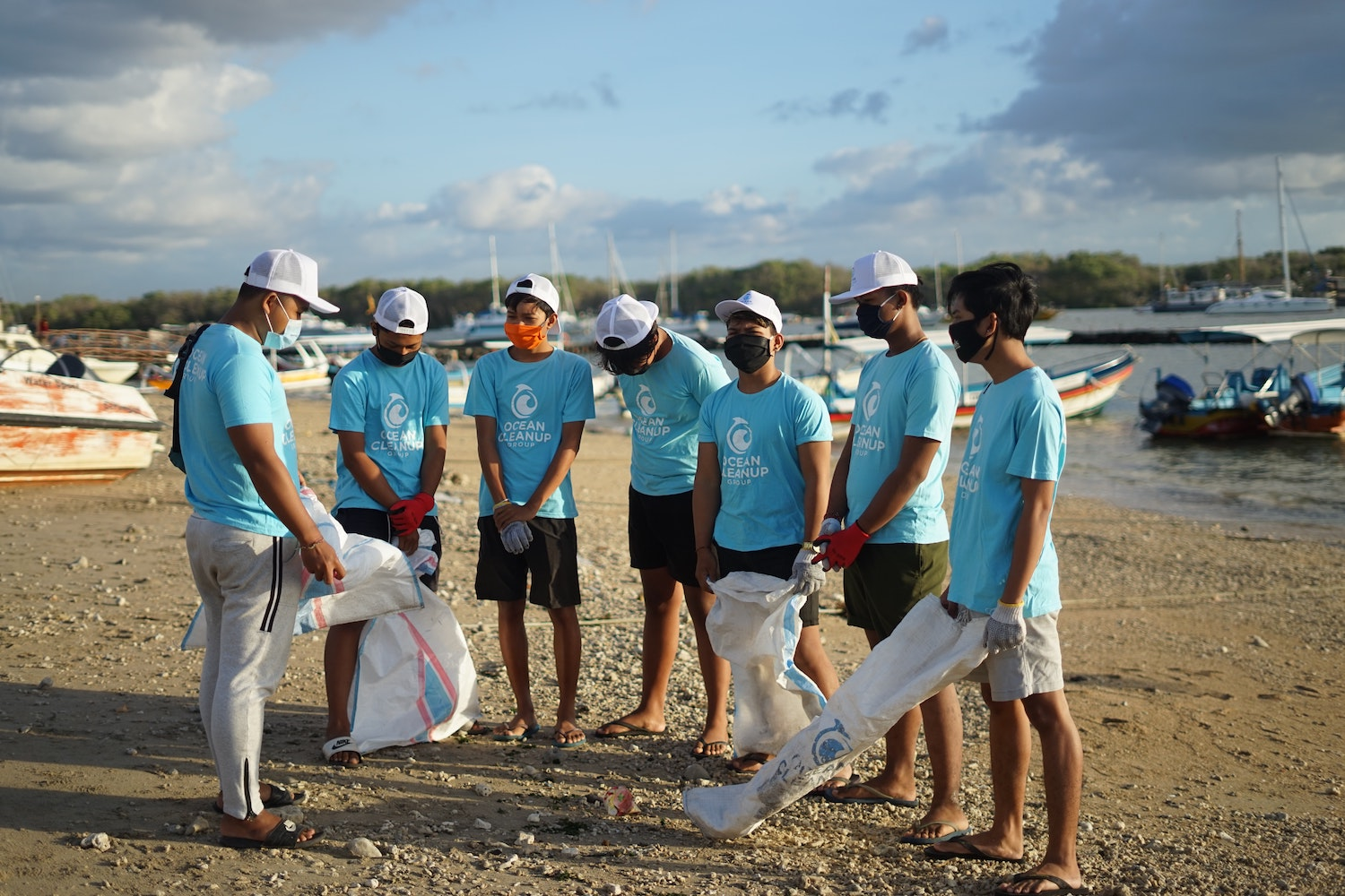 A group of young men getting ready for an ocean cleanup project